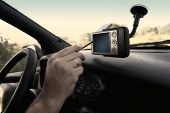 stock photo of gps navigation  - Pocket PC with GPS module attached to the windscreen - JPG