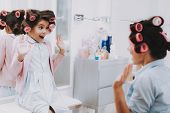 Little Lady With Curlers. Girl In Beauty Salon. Look In Amazement. Consept Beauty Salon. Beautiful L poster