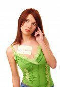 Beautiful woman with 'don't know' sticky note attached to her shirt