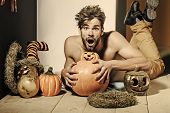 Halloween Autumn And Harvest Season. Man With Open Mouth And Bared Torso Lying On Floor. Trick Or Tr poster