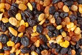 Mixed raisins of different colors close up