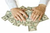 Greedy hands grabbing heap of money US  dollars