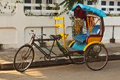 stock photo of rickshaw  - Empty bicycle rickshaw in street - JPG
