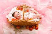 picture of newborn baby girl  - Cute baby girl in the basket with apples - JPG