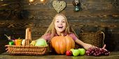 Fall Harvest Holiday. Child Presenting Harvest Vegetable Garden Wooden Background. Elementary School poster
