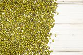 Lot Of Whole Dry Green Mung Beans Flatlay On White Wood poster
