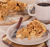 Slice Of Dutch Apple Pie On A Brown Plate With A Cup Of Coffee And Sliced Pie On A Wooden Platter In poster