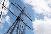 Mast And Rigging Of An Historic  Sailing Ship Against The Blue Sky With Clouds, Adventure Voyage Con poster