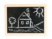 House. tree and sun  on chalk board