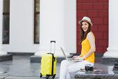 Amazed Traveler Tourist Woman In Casual Clothes, Hat With Suitcase Sit Using Work On Laptop Pc Compu poster