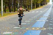 picture of inline skating  - Roller skating at autumnal park - JPG