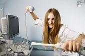 Joyful doctor with ultrasound investigation sensors in hands