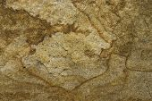 picture of fieldstone-wall  - an old natural stone texture with cracks - JPG