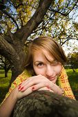 Young beautiful homely woman in park