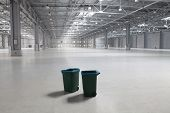image of dustbin  - Two dustbins in large modern storehouse - JPG