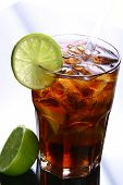 stock photo of iced-tea  - a fresh ice tea glass with lime - JPG
