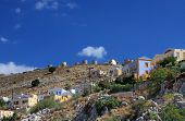 Greece. Dodecanesse. Island Symi (Simi). Colorful houses on rocks