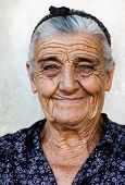 picture of old lady  - Image shows a happy old lady from a village in Greece - JPG
