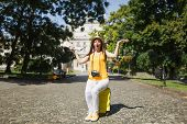 Young Irritated Angry Traveler Tourist Woman In Yellow Clothes Sitting On Suitcase Hold City Map Spr poster
