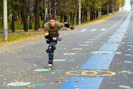 picture of inline skating  - Roller skating at autumnal park - JPG