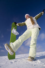 stock photo of winter sport  - Happy girl with snowboard at sunny day at winter - JPG