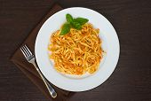 linguine pasta with tomato sauce overhead on white plate