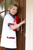 picture of geriatric  - Geriatric nurse makes a house call and rings the door - JPG
