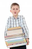 The Schoolchild With A Huge Pile Of Heavy Books In Hands.