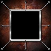 Metal Frame On A Copper Grunge Wall