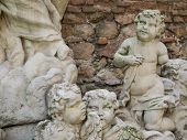 picture of cherub  - Group of several ancient stone cherub angels - JPG