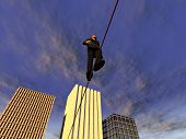 foto of aerialist  - man walking on a tightrope above the city - JPG