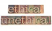 ethical and unethical words - isolated text in vintage letterpress wood type stained by color inks