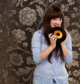 Woman Biting Disc, Indoor