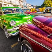 HAVANA-AUGUST 14:Classic vintage cars in front of the Central Park August 14,2012 in Havana.These ol