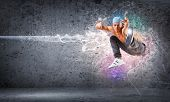 stock photo of break-dance  - young man in a blue cap dancing hip hop  - JPG