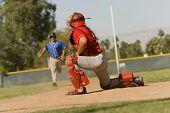 Baseball runner approaching catcher on field