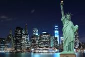 foto of statue liberty  - Manhattan Skyline and The Statue of Liberty at Night - JPG