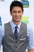 vLos Angeles - AUG 19:  Harry Shum Jr arrives at the 2012 Do Something Awards at Barker Hanger on August 19, 2012 in Santa Monica, CA