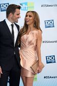 Los Angeles - AUG 19:  Bill Rancic, Giuliana Rancic arrives at the 2012 Do Something Awards at Barke