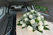 foto of mortuary  - A coffin in a mourning car with a flower arrangement - JPG