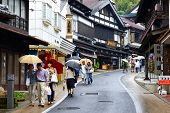 NARITA, JAPAN - OCTOBER 6: Shoppers pass through Sando traditional street October 6, 2012 in Narita, JP. The historic town is a popular destination located near Narita International Airport.