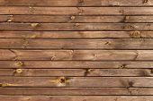 Bruin geschilderde houten muur - structuur of achtergrond