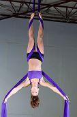 Gymnast performing aerial exercises