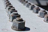 stock photo of bolts  - Weathered bolts on a steel beam - JPG