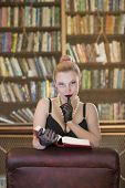 stock photo of kinky  - Beautiful caucasian woman being kinky in old library - JPG