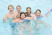 image of young boy  - Five young friends in swimming pool playing and smiling - JPG