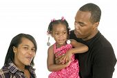 stock photo of niece  - African american man holding his niece in his arms with his sister stand by isolated over white - JPG
