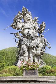 stock photo of mahabharata  - Kumbakarna Laga statue in Eka Karya Botanical Garden Bedugul Bali Indonesia - JPG