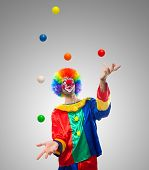 stock photo of juggling  - Funny clown juggling many balls - JPG