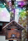 stock photo of mailbox  - Colorful modern icons and symbols bursting out of a mailbox - JPG